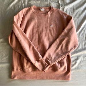 Light orange crew neck sweatshirt